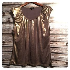 Stand out in this Gold top-B